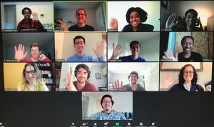 A grid of Zoom windows with 13 people waving at the screen.